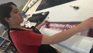 Installing a retractable banner stand top bar